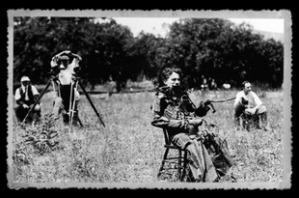A nice shot of Chaplin directing the movie while in costume. Note the pointing branch.