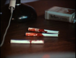 (But they did manage to squeeze in a shot of the cigarettes that a wounded Neff retrieved from his shirt pocket.)