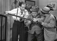 Glass with Curly and Moe Howard in the Three Stooges short
